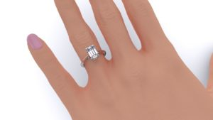Adelaide Diamond company 4 claw emerald cut solitaire engagement ring hand